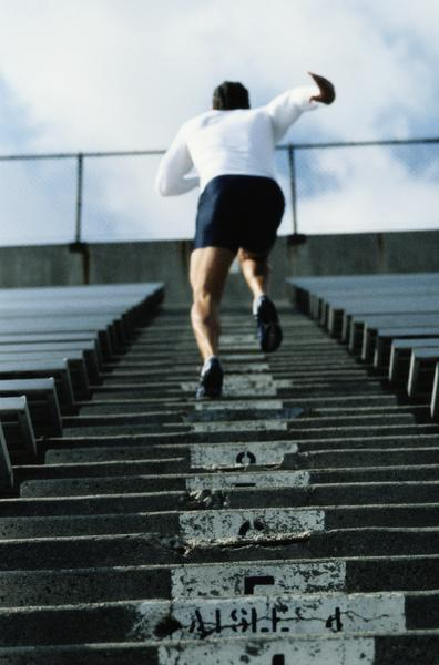 man running stadium steps